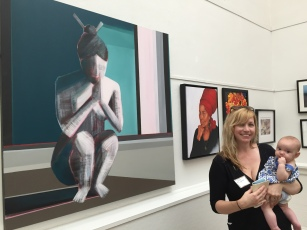 """Artist Shilo Ratner in front of painting """"Essence""""."""